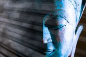 Buddha Face Close-up. Spiritual Enlightenment. Zen Buddhism. Traditional Thai Statue With Ethereal L poster