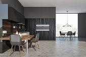 Dark Wooden Kitchen Interior With Table poster