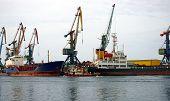 stock photo of sakhalin  - Seaport on Sakhalin beside quay ship on lifting taps - JPG