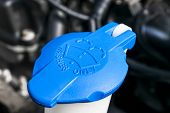 Car Windshield Wiper Cleaning Spray Water Reservoir Blue Bottle Cap In Car Engine Space. Car Detaili poster