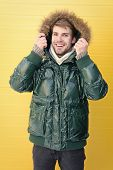 Eliminating Cold Spots. Handsome Man Wearing Faux Fur Hood. Casual Fashion Coat For Cold Winter Cond poster