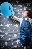 The Child Is One Month Old. A Newborn At The Age Of One Month Lies Happily. Baby And Ball With The I poster