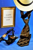 Happy Fathers Day-tie, Hat, Sunglasses, Spinning Fishing On Creative Blue Background. An Annual Cel poster