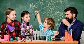 Explaining Chemistry To Kids. Fascinating Chemistry Lesson. Man Bearded Teacher And Pupils With Test poster