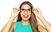 Eyewear Glasses Woman Portrait. Smiling Young Woman Wearing Glasses And Holding Frame. Beautiful Fem poster