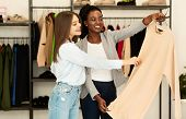 Fashion Consultant. Personal Stylist Choosing Fashionable Designer Clothing For Her Client In Showro poster