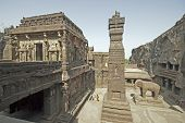 picture of ellora  - Stone elephant statue and obelisk outside the ancient Hindu Temple  - JPG