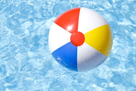image of beach-ball  - Colorful beach ball floating on a swimming pool - JPG
