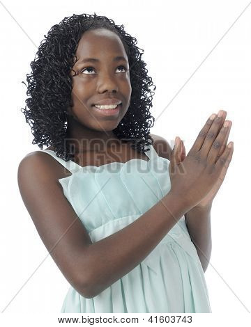 Close-up image of a beautiful tween happily looking heavenward in prayer.  On a white background.