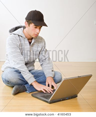 Teenager And Laptop Computer