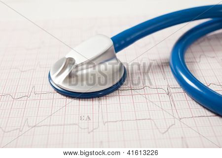 Detail of a stethoscope on a electrocardiogram