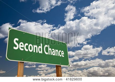 Second Chance Green Road Sign Over Clouds and Sky.
