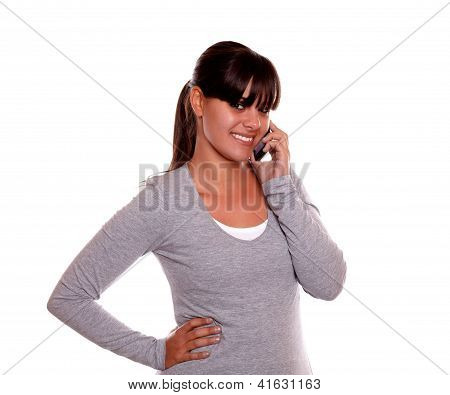Young Woman With Fringes Speaking On Cellphone