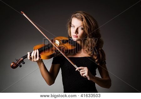 Woman performer with violin in studio