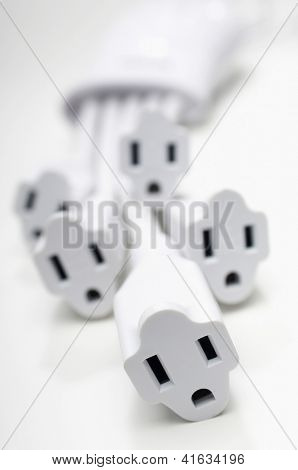 Closeup of few cord sockets isolated over white background