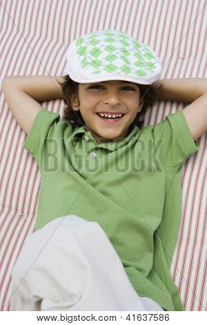 High angle view of a preadolescent boy relaxing on bed