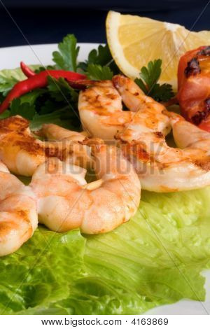 Grilled Prawns On Bamboo Sticks Served On Lettice