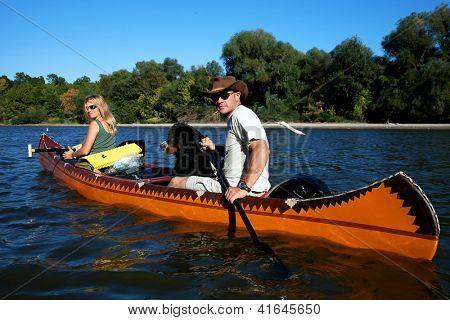 Young couple enjoying a trip in a canoe