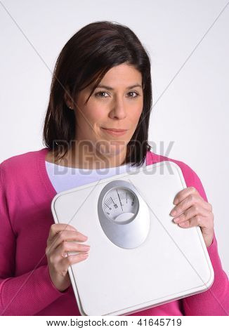 Happy fat woman holding a weight scale.
