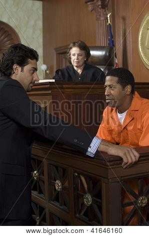Advocate with defendant and judge sitting in the background