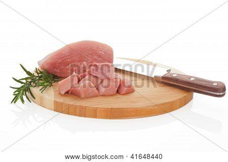 Raw Pork On Chopping Board.