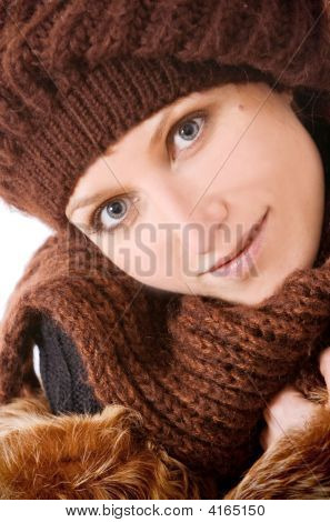 Girl In A Knitted Cap Smiles