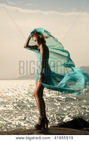 Portrait Of Fashion Woman In Fluttering Blue Dress