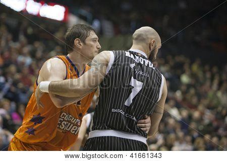 VALENCIA - JANUARY 29: #12 Serhiy Lischchuk and Milovan Rakovic during Bakestball match between Valencia Basket Club and Uxue Bilbao, on January 29, 2013, in La Fonteta Stadium, Valencia, Spain