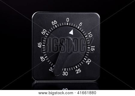 Black Egg Timer With A Reflection