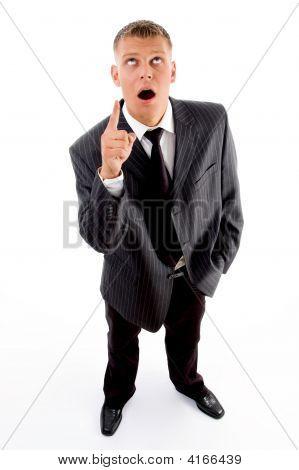 Shocked Standing Businessman Pointing Upside