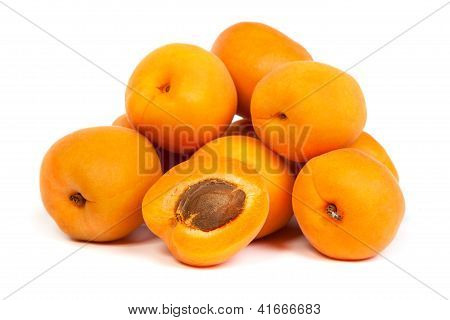 Group Of Ripe Apricots With A Half
