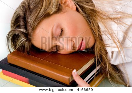 Portrait Of Sleeping Student On Book
