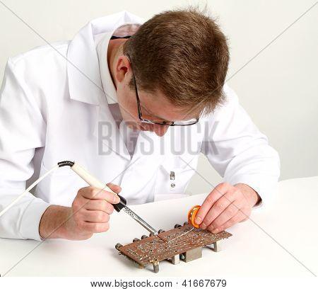 Working Electronics Repairing Board Using Soldering Pen