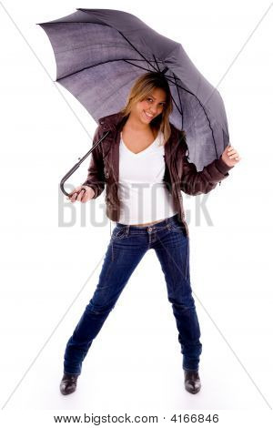 Front View Of Young Woman Carrying Umbrella