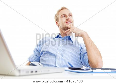Young Man At Office Daydreaming