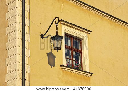 Close-up Yellow Building With Window And Street Lamp