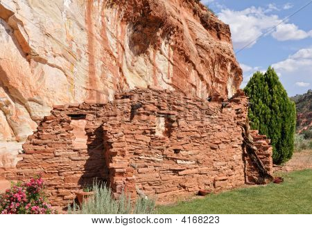 Ancient Wall Under Rock