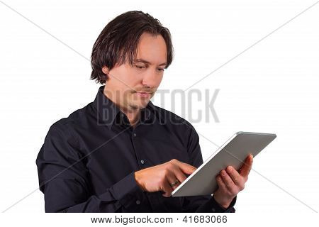 Man Browsing On A Tablet Computer