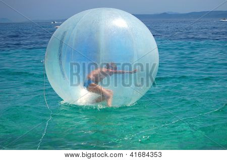 Teenage boy in air ball on Golden Cape in Croatia