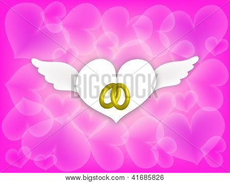 Wedding Rings in Angle Hearth on Pink Background