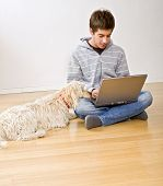 Teenager And Laptop Computer And Dog