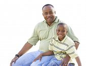 stock photo of pre-adolescent child  - Happy African American Man and Child Isolated on a White Background - JPG