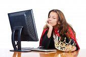 foto of superwoman  - Superwoman worker with crown working in office - JPG