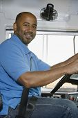 stock photo of bus driver  - Portrait of an African American bus driver smiling - JPG