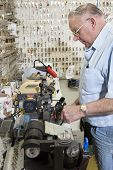 image of locksmith  - Side view of locksmith working in key store - JPG