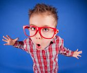 image of misbehaving  - Funny five years old boy with expressive face - JPG