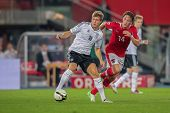 VIENNA,  AUSTRIA - SEPTEMBER 11 Toni Kroos (#18 Germany) and Julian Baumgartlinger (14 Austria) figh