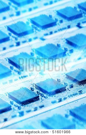 Closeup picture of computer parts in blue shining light