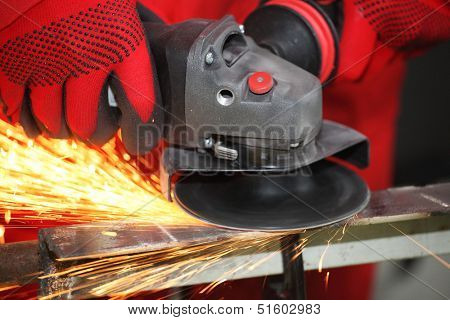 Metal sparks from the grinding machine