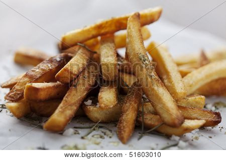 golden crispy french fries with salt and herbs